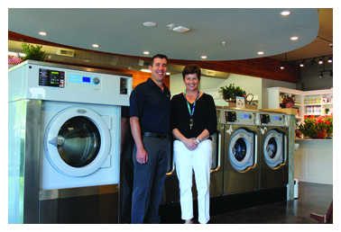 Colleen Unema, owner of Q Laundry, with Rob Chateau, Regional Business Manager at Laundrylux