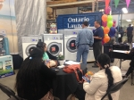 John Olsen, Laundrylux VP of Vended Products, at Ontario Laundry Systems annual show.