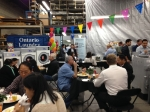 Lines at Ontario Laundry Systems Annual Open House and Product Show.